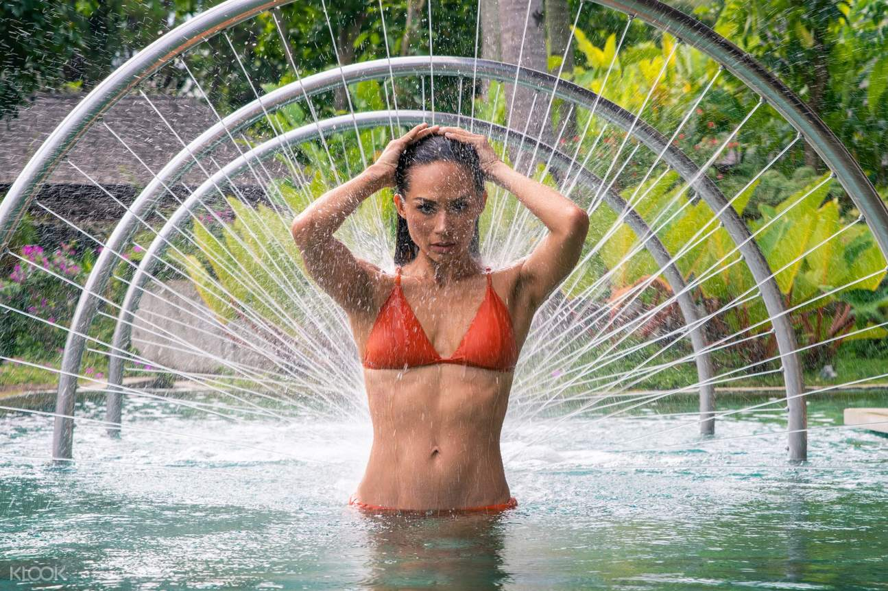 Woman in bikini taking blind shower at The Farm at San Benito in Batangas