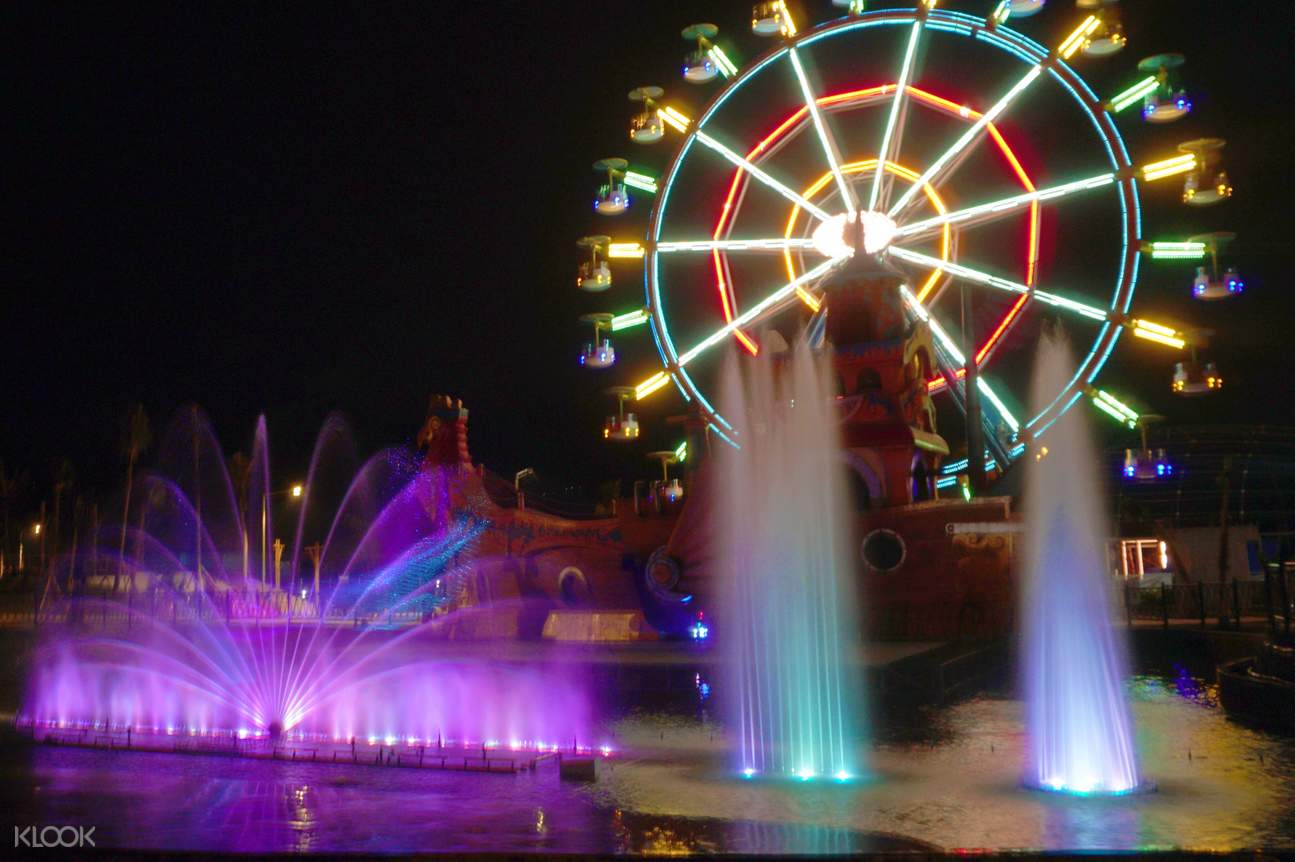 the colorful fountains and Ferris wheel of Saloka Theme Park at night