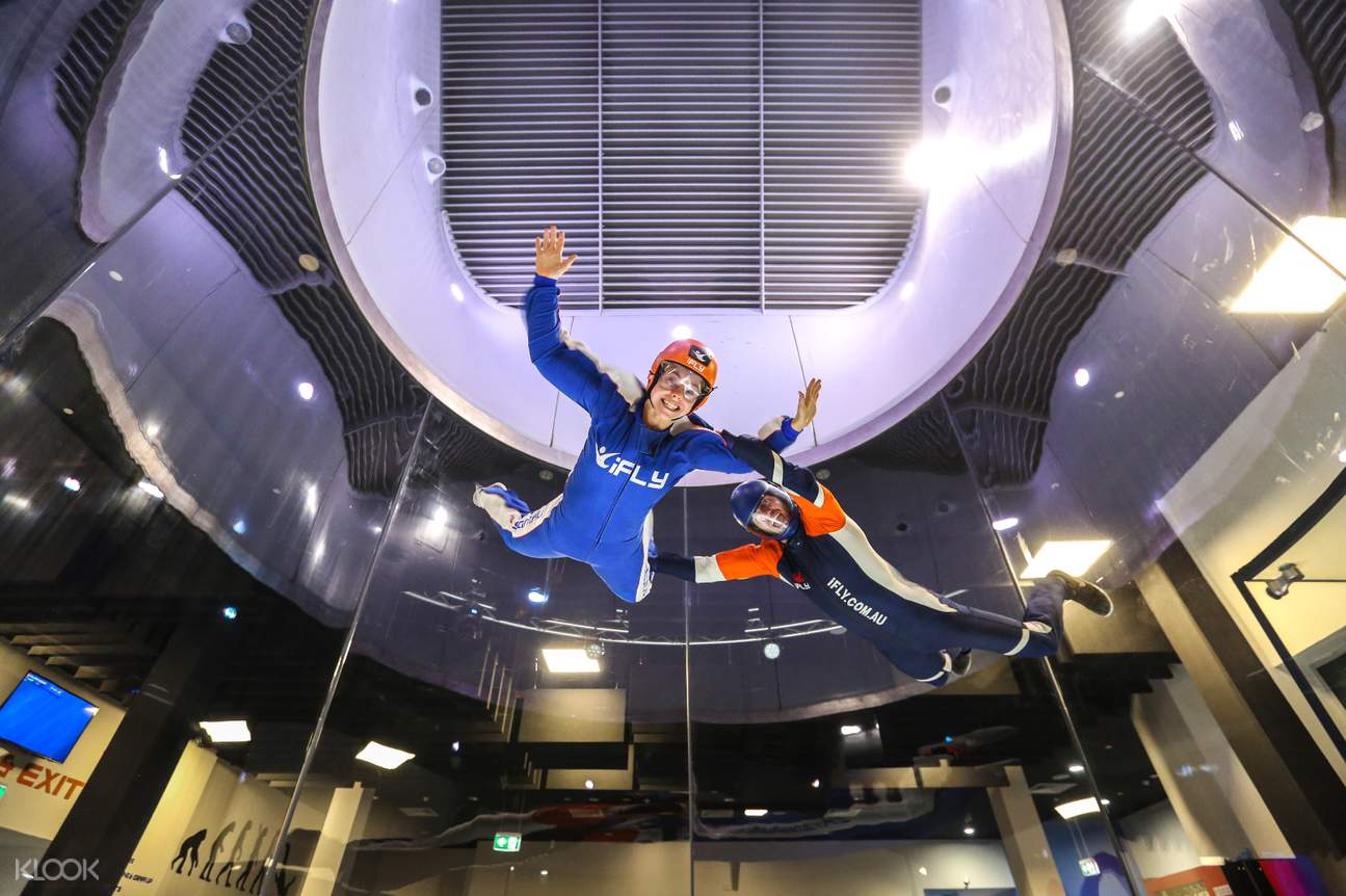 a woman enjoying the skydiving simulation of iFLY Downunder