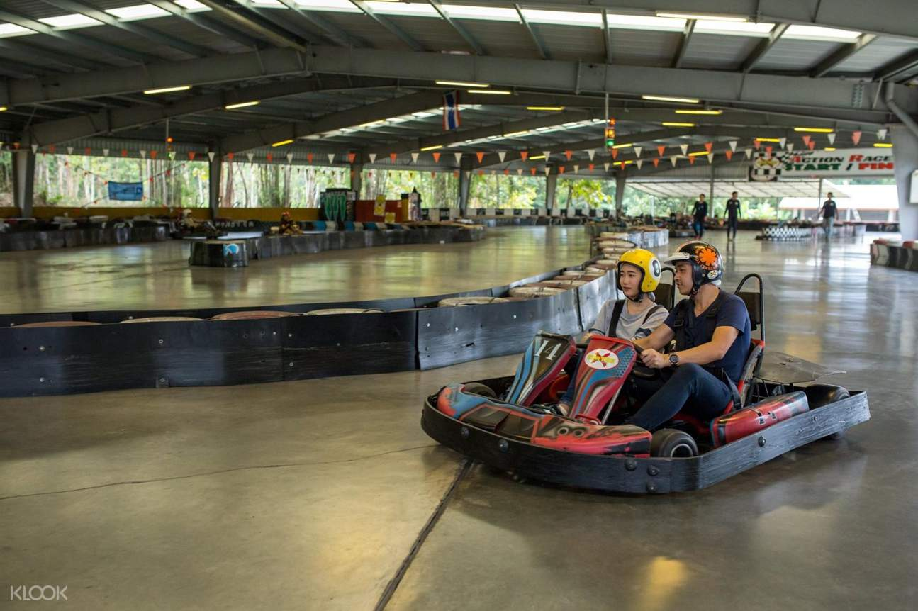 Couple driving kart at Chiang Mai X-Centre