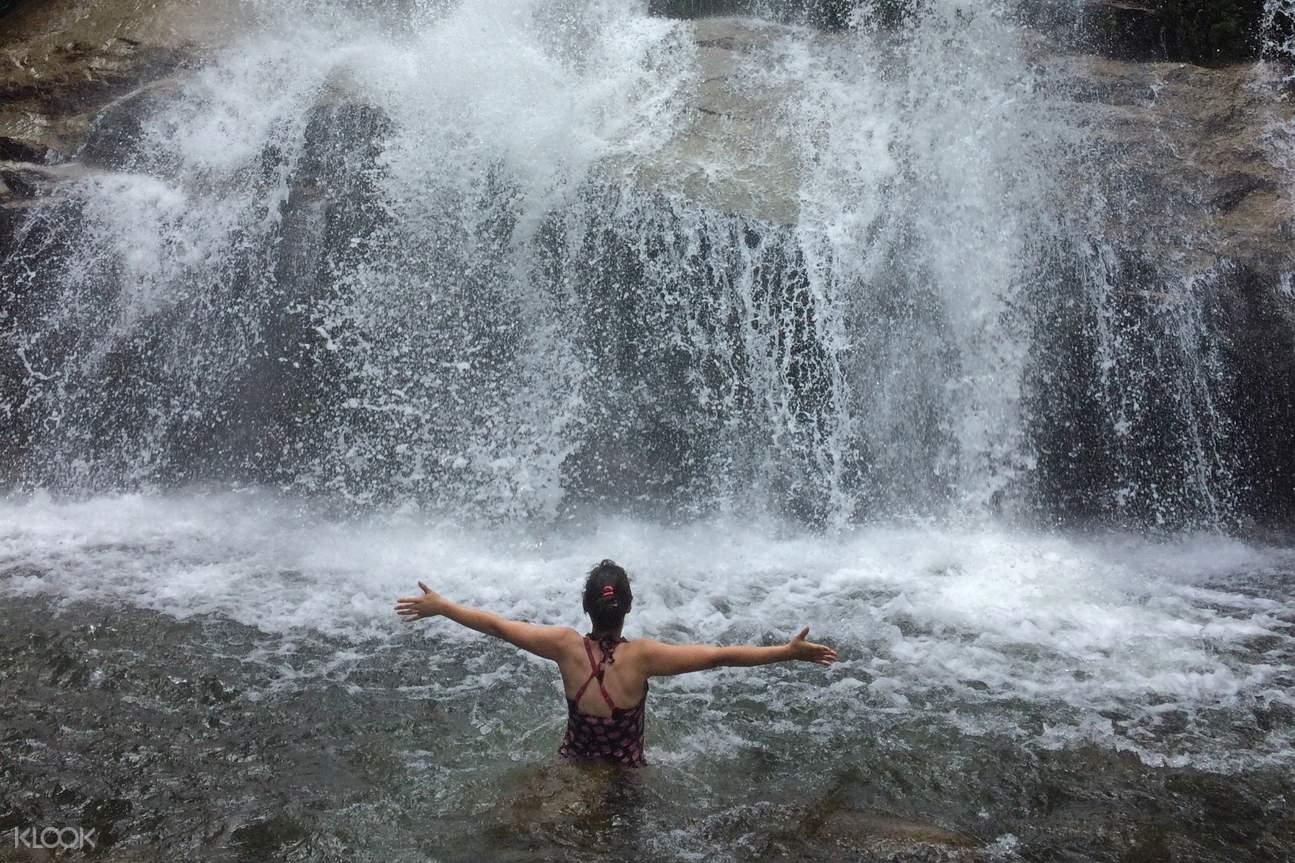 woman in the waterfall