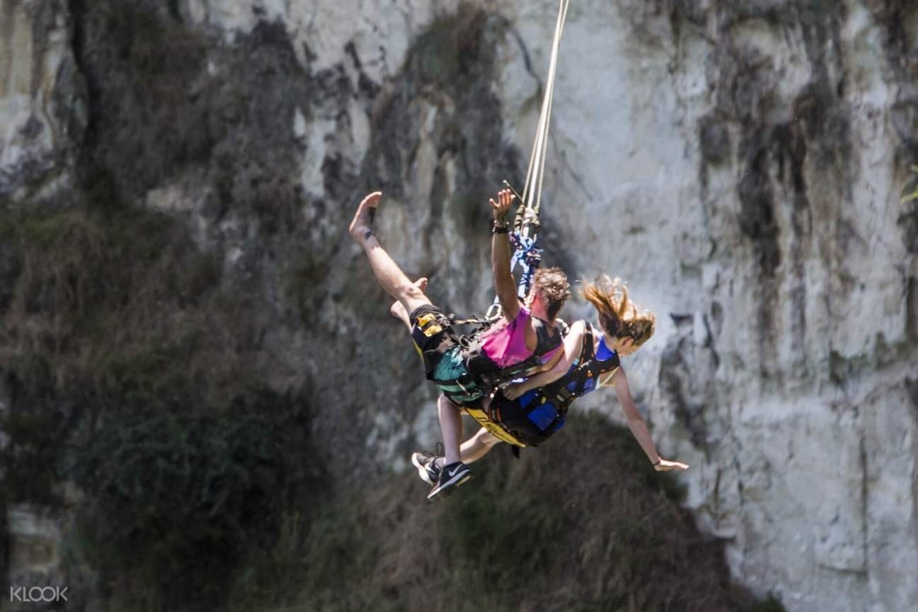 two persons extreme swinging