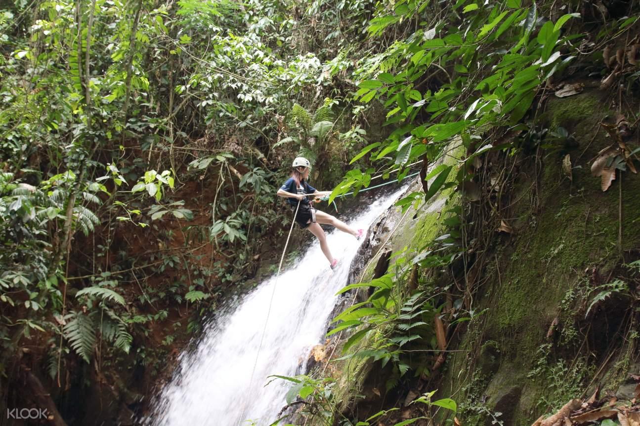 woman waterfall abseiling in malaysia