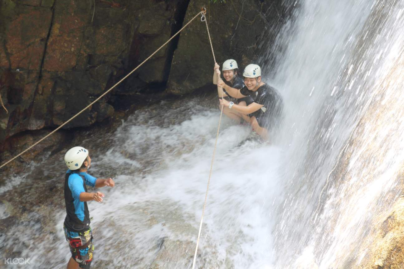 couple waterfall abseiling with a guide
