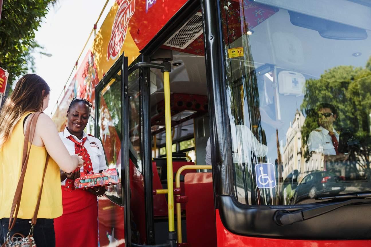 woman riding Kazan Hop-On Hop-Off bus