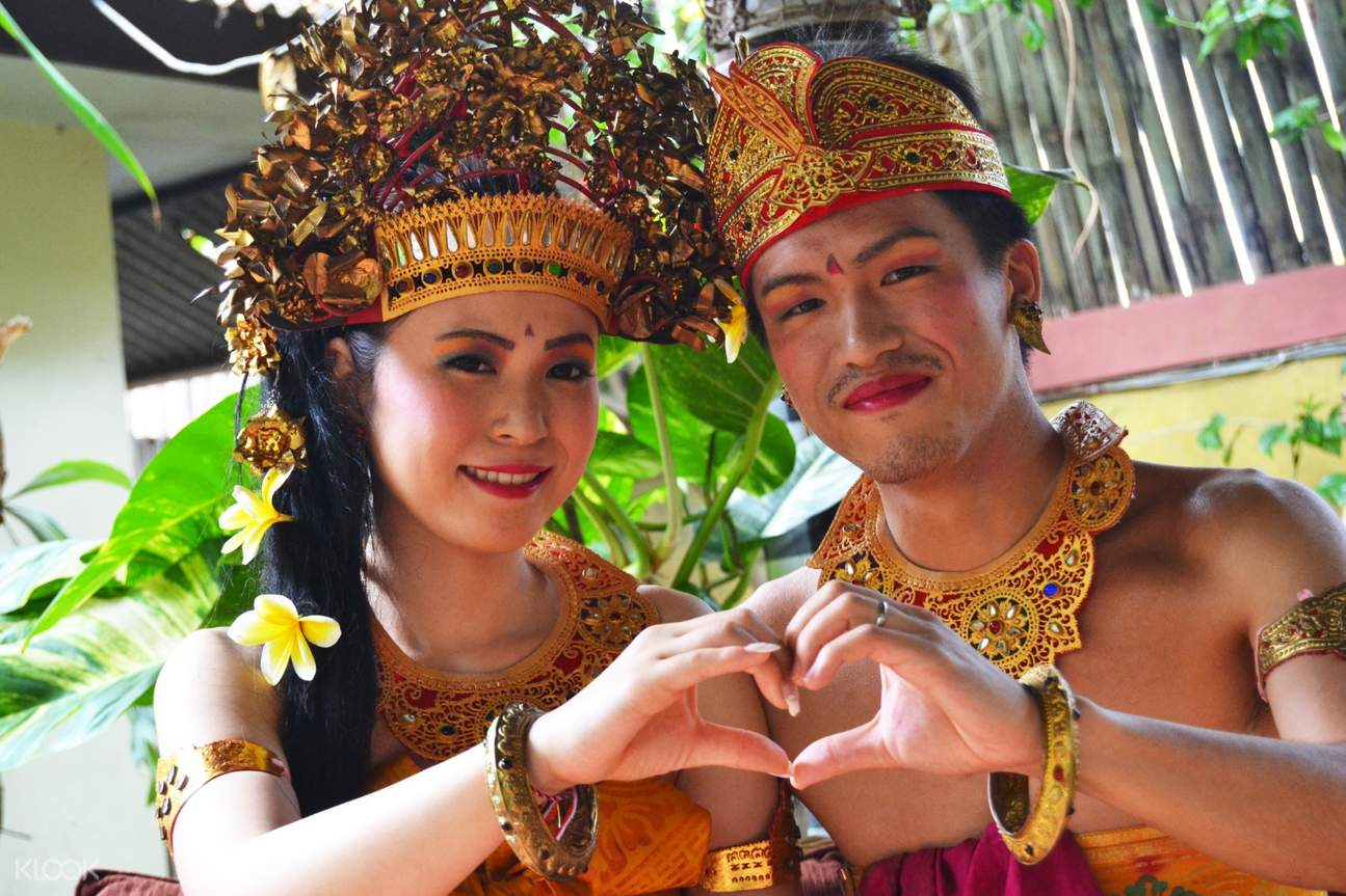 man and woman wearing traditional Balinese clothing