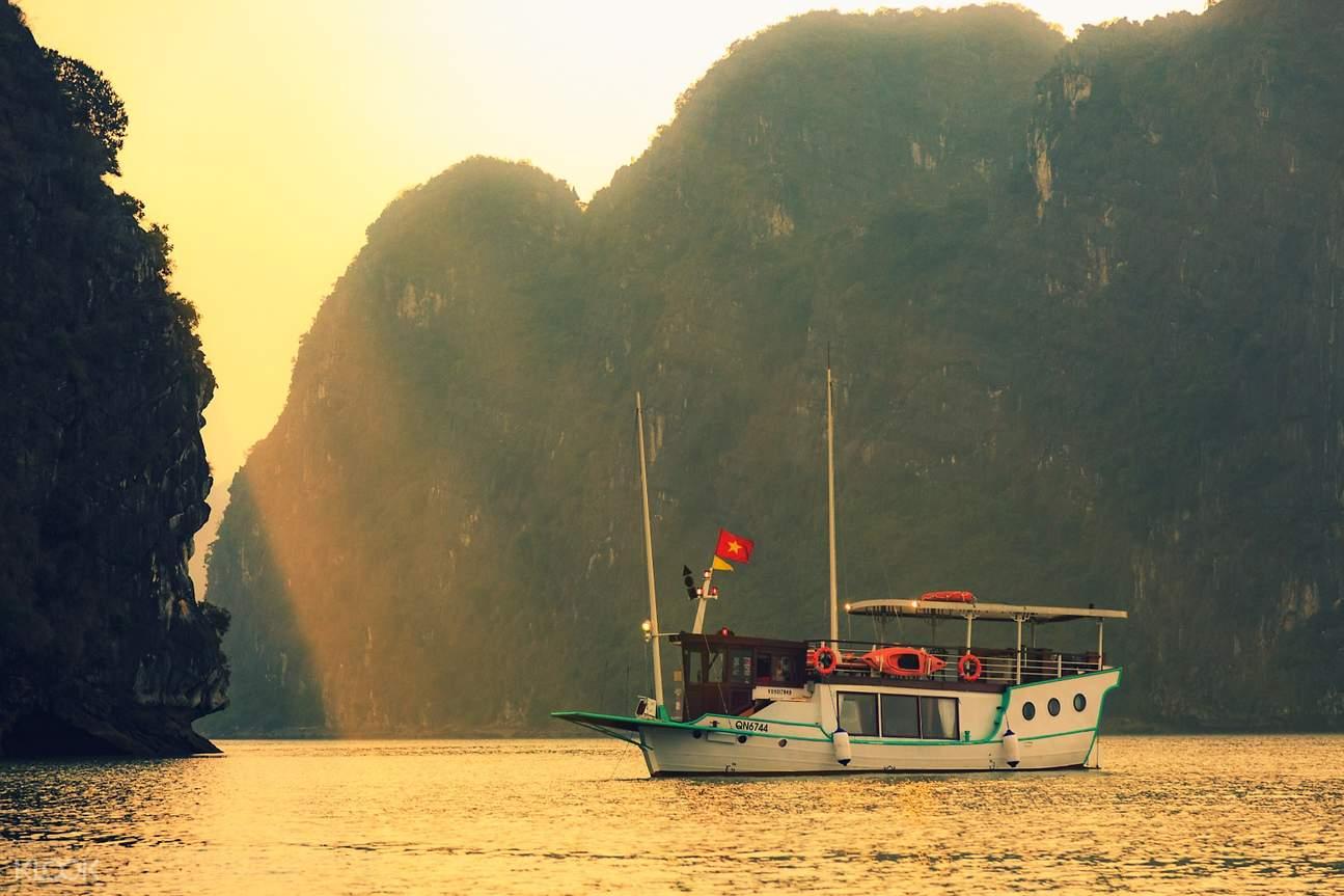 cruise boat on halong bay during sunrise