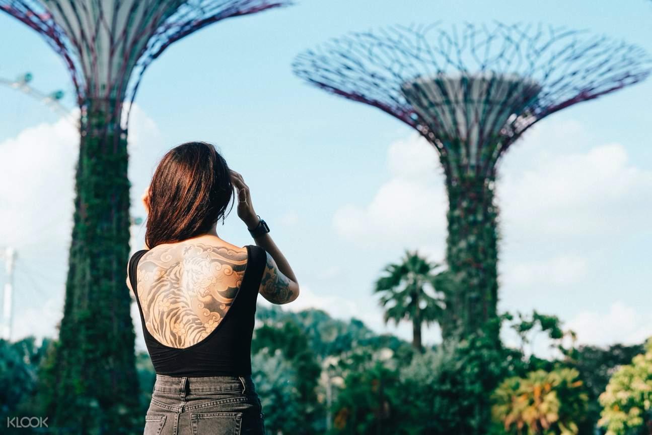 woman posing against singapore's super trees