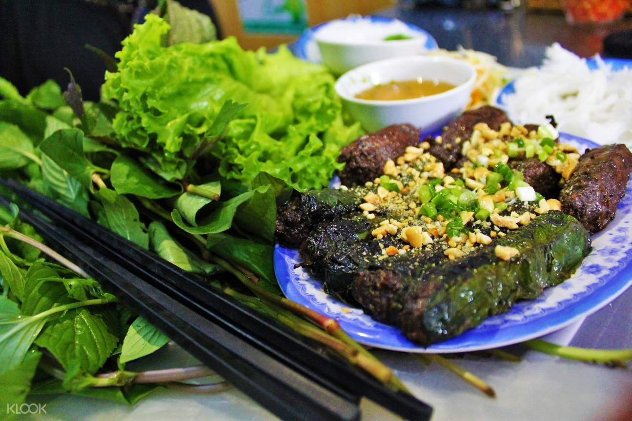 beef in wild betel leaf street food sightseeing night tour aodai rider saigon