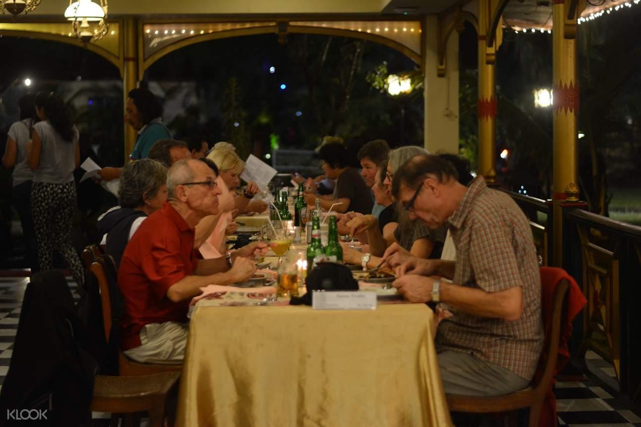 people enjoying their dinner in the ramayana ballet