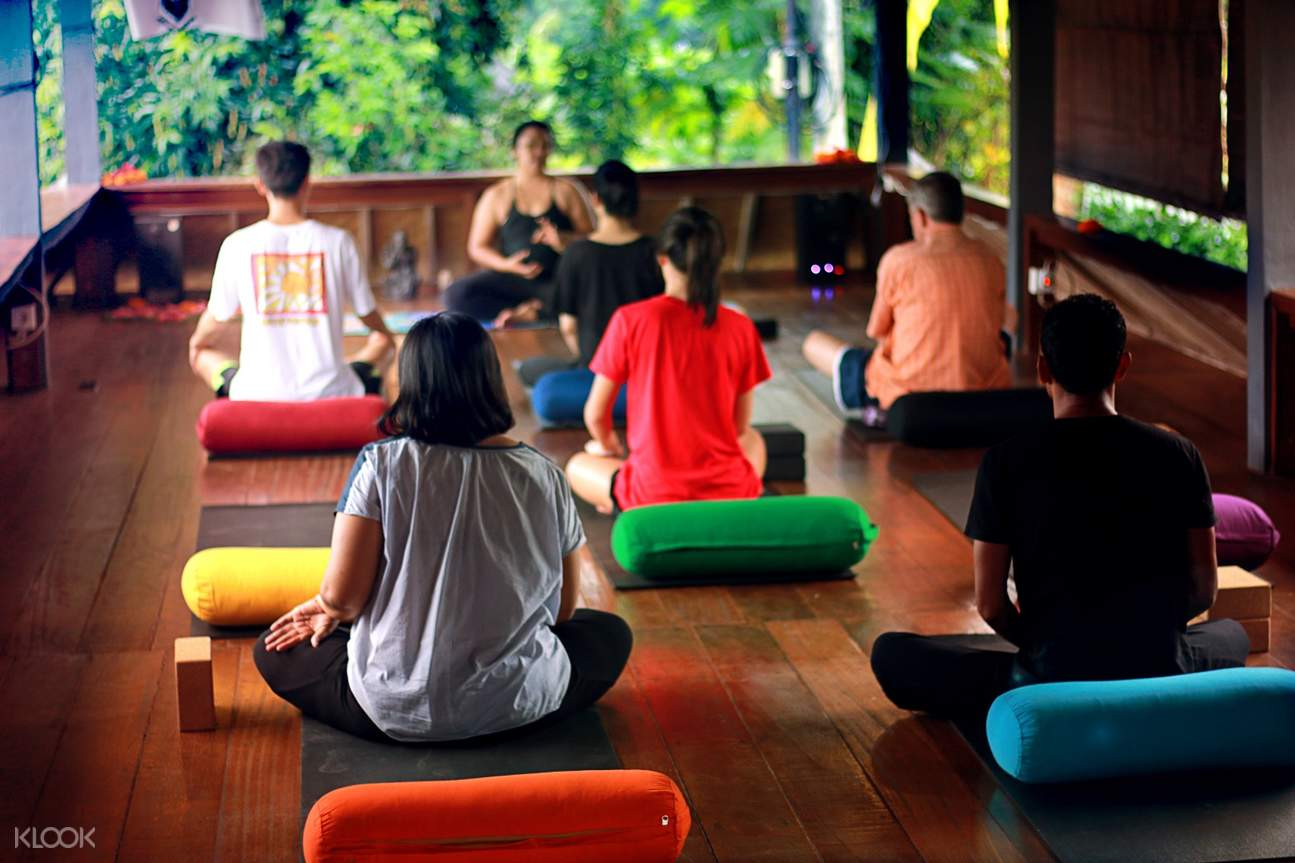 yoga students and instructor in sitting position