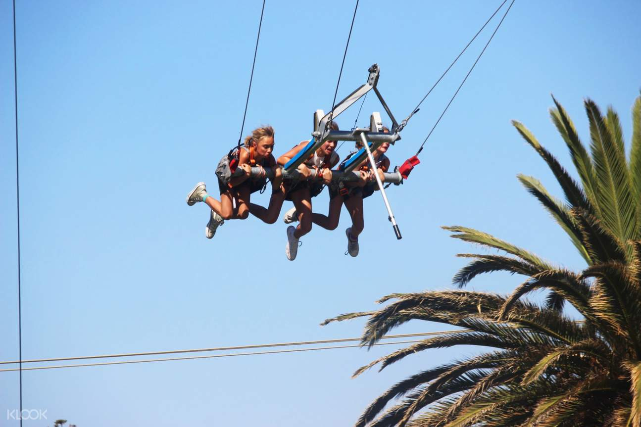 three people in giant swing