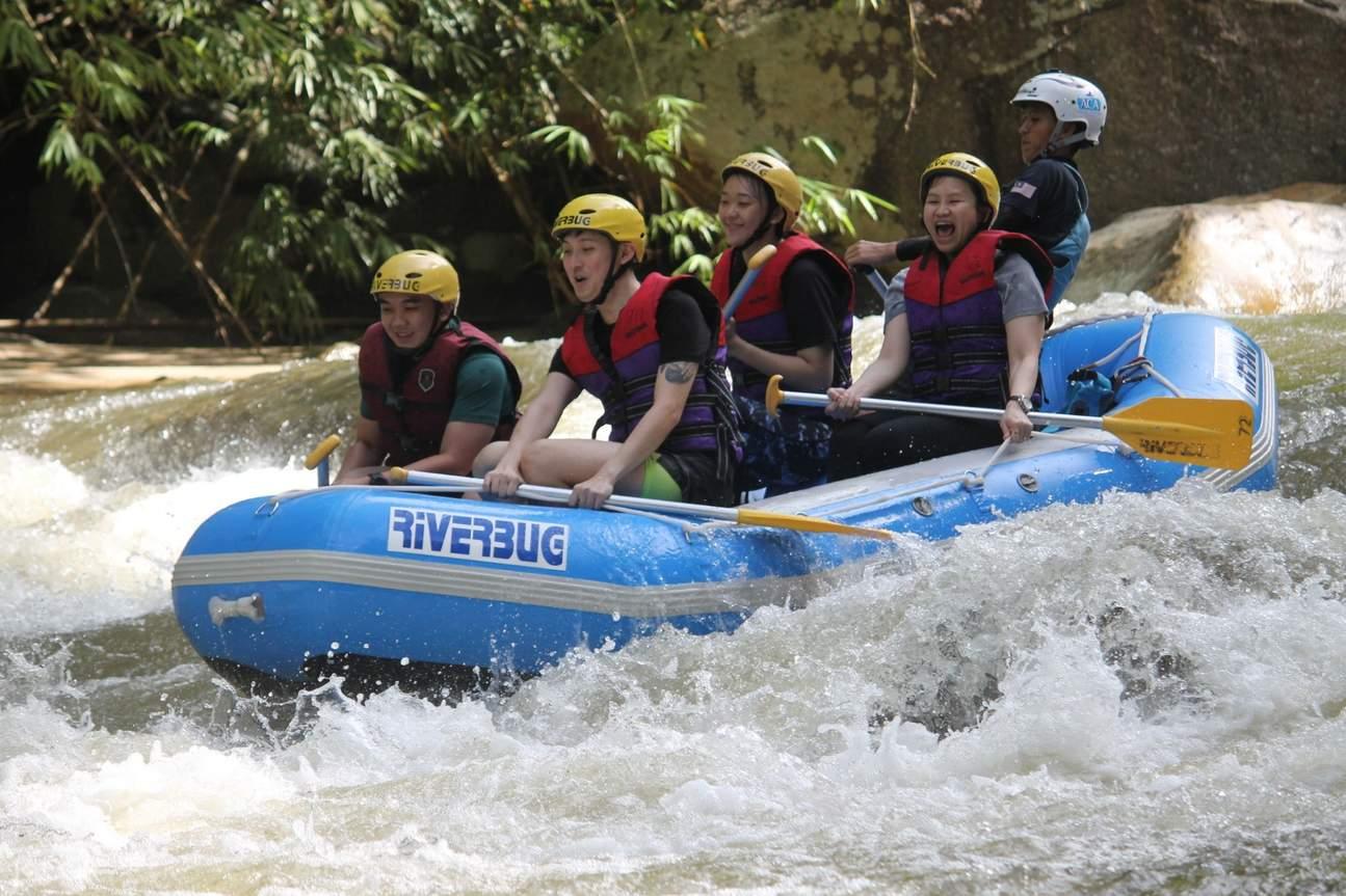 group of people rafting at kampar river