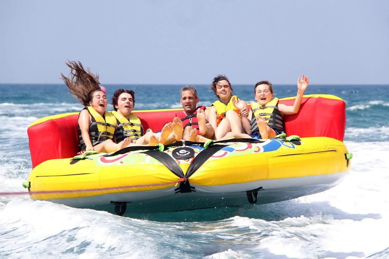 group of people having fun in the sea