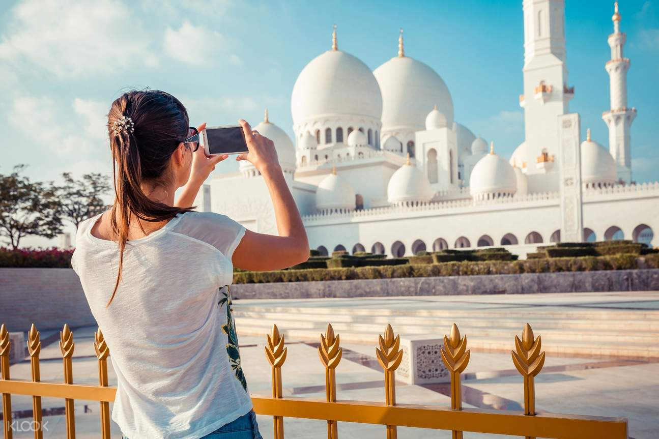 tourist taking photo of mosque