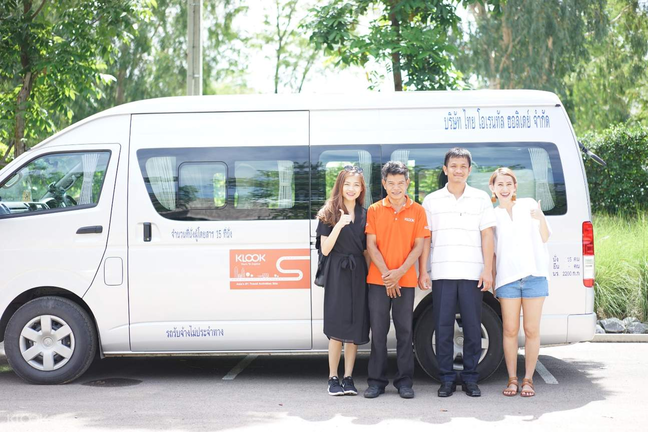 tourists posing with their guide and driver