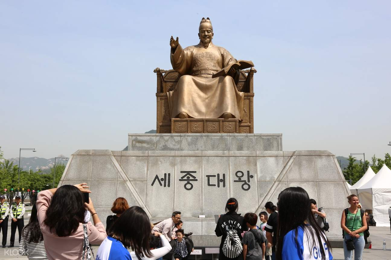 tourists visiting the statue of king sejong