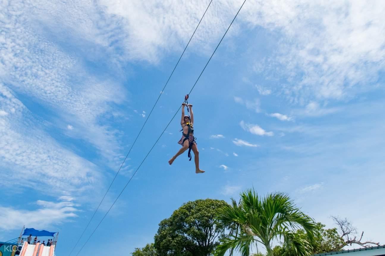 woman using the zipline in high park samui koh samui