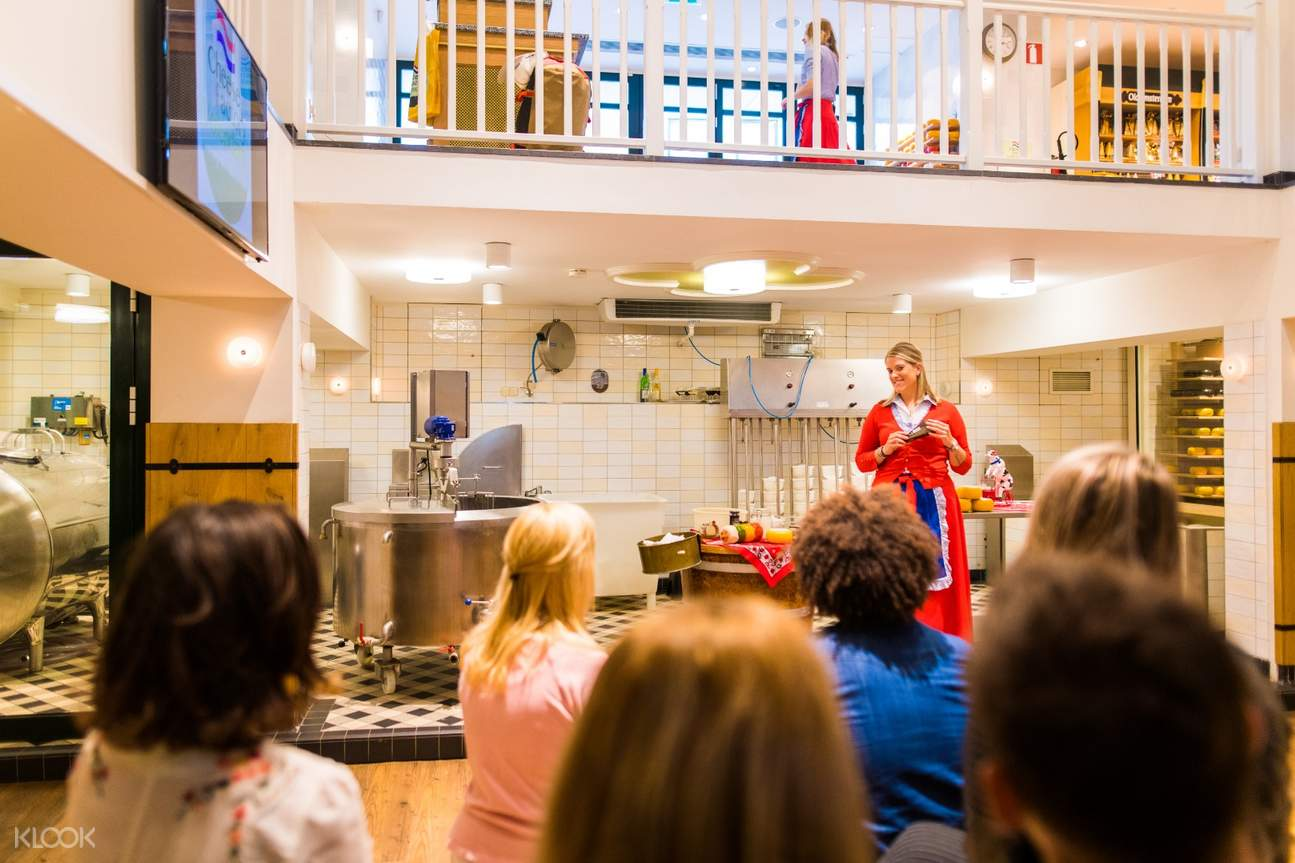 tourists inside the cheese factory in volendam