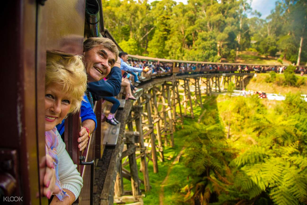 People riding the Puffing Billy Steam Train
