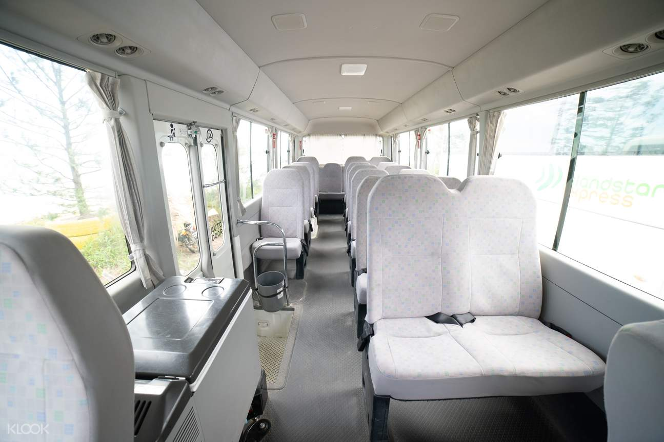 coaster interior of a Kalibo International Airport transfer