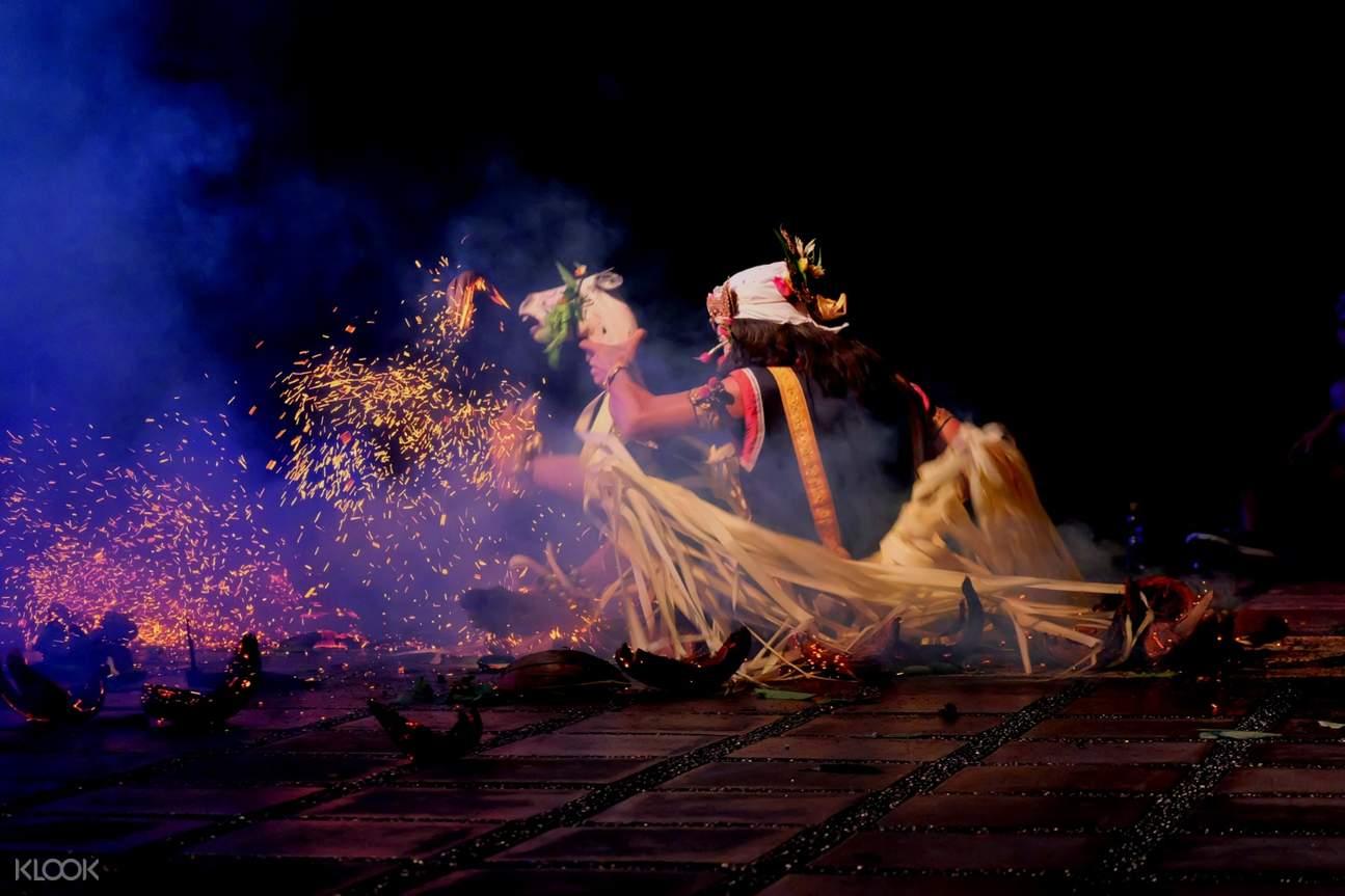 kecak performer near a bonfire