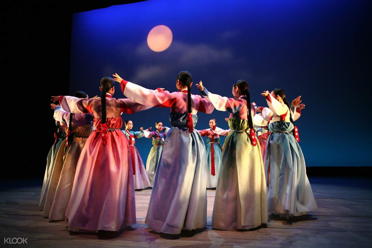 korean women in hanbok dancing in a circle