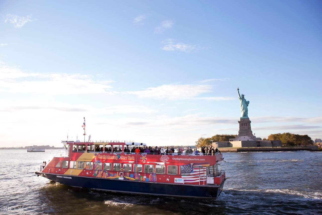 sightseeing ferry cruise along hudson river with statue of liberty in the background