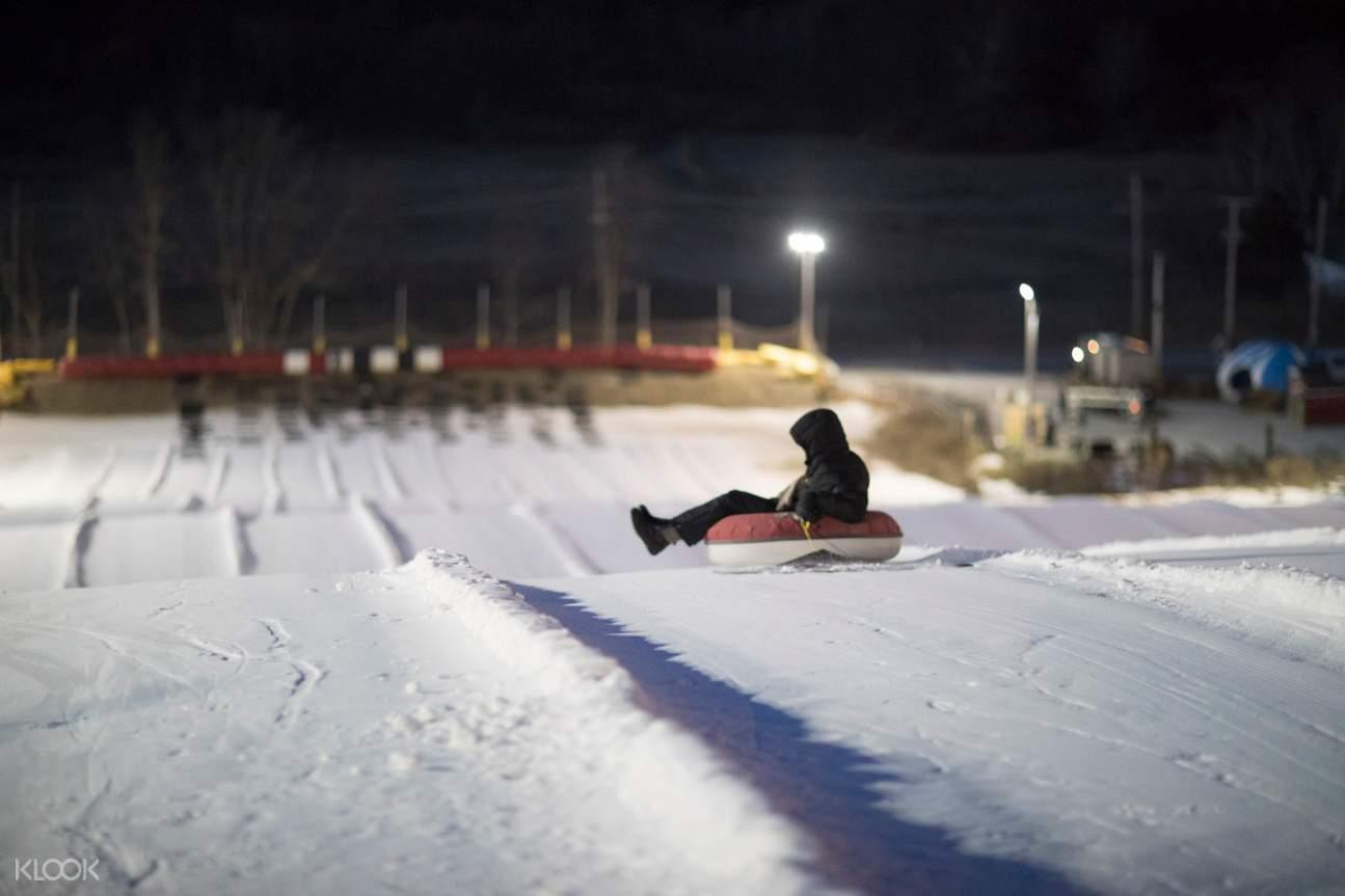 guy tubing on snow