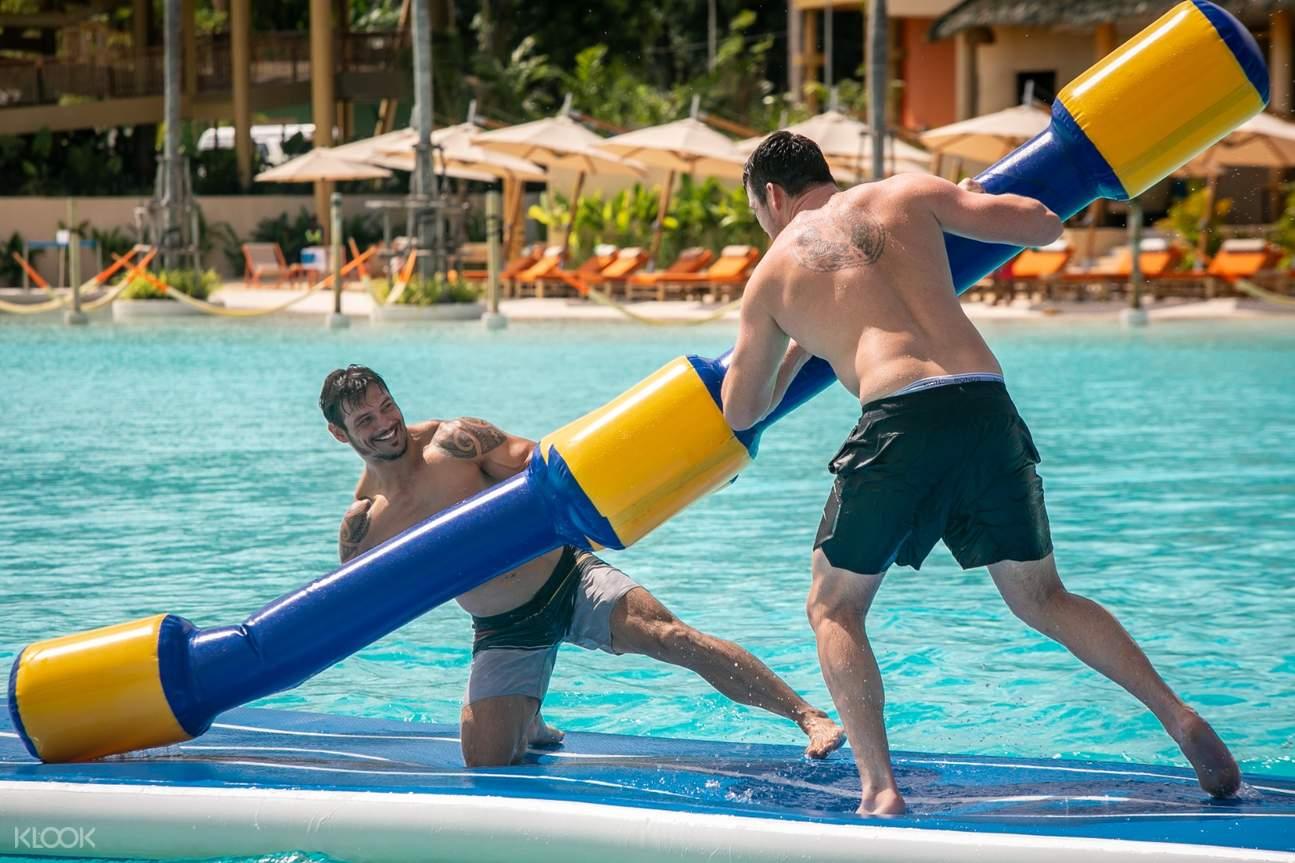 two men water jousting