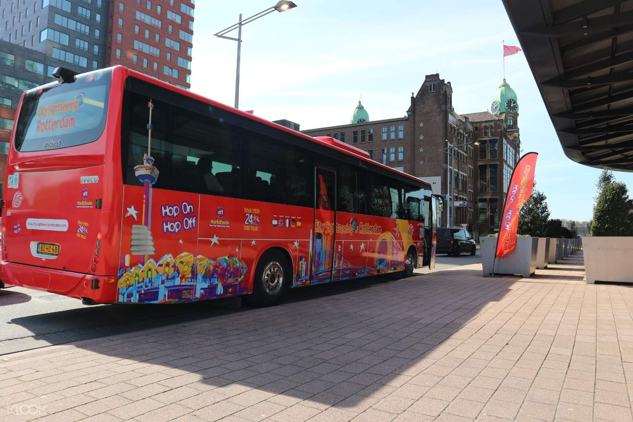red sightseeing bus in rotterdam