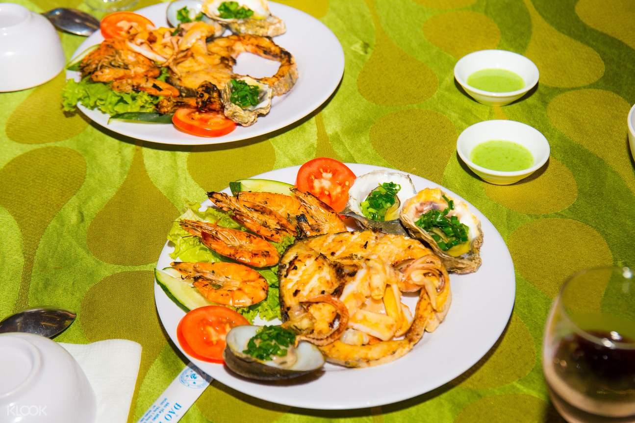 Enjoy dinner at Yen Dong Tam island restaurant with sea food menu