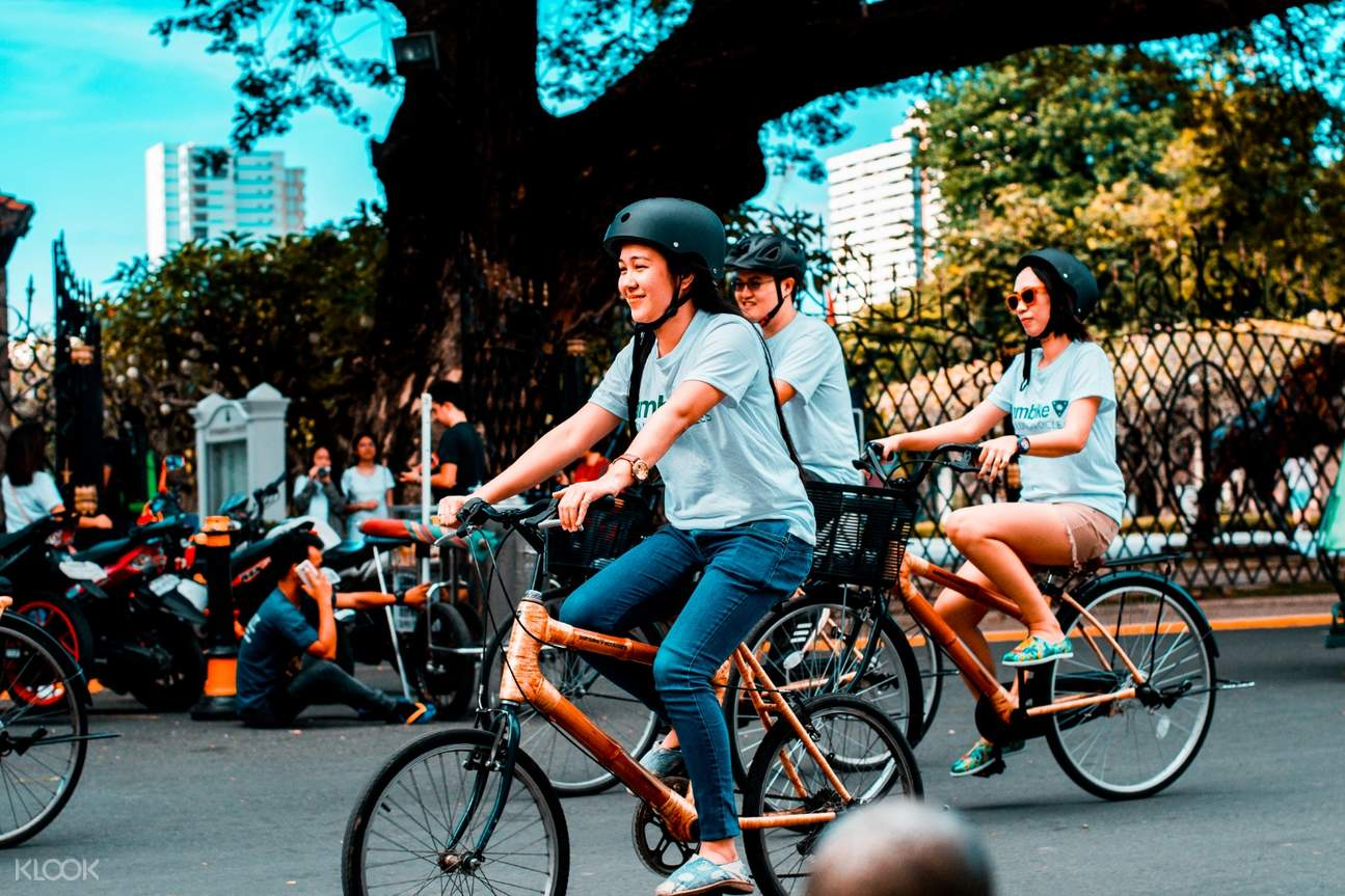 people riding bambikes in intramuros