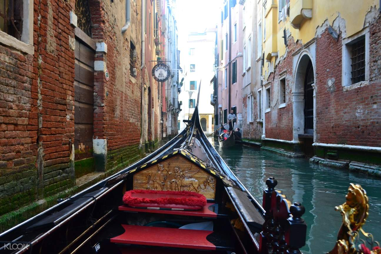 plush seating and vintage carved design on wood etched on the gondola's interiors