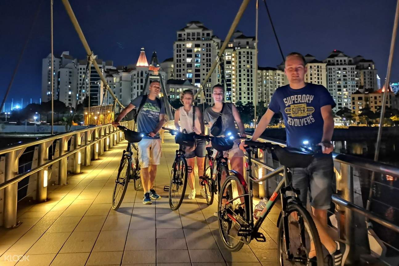 tourists along  a bridge at Marina Bay
