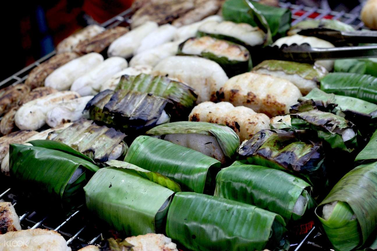 grilled banana sticky rice cake street food sightseeing night tour aodai rider saigon