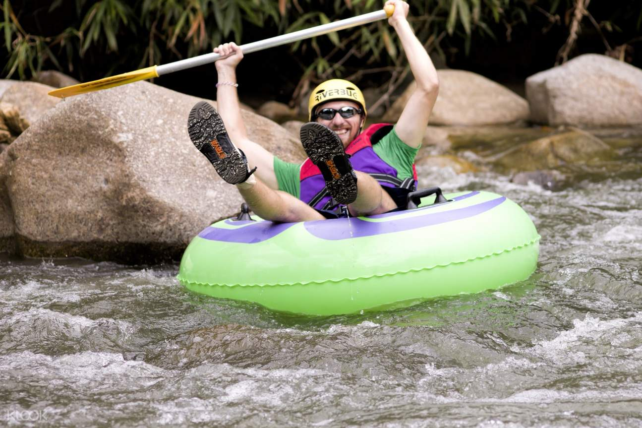 a guy river tubing while in malaysia