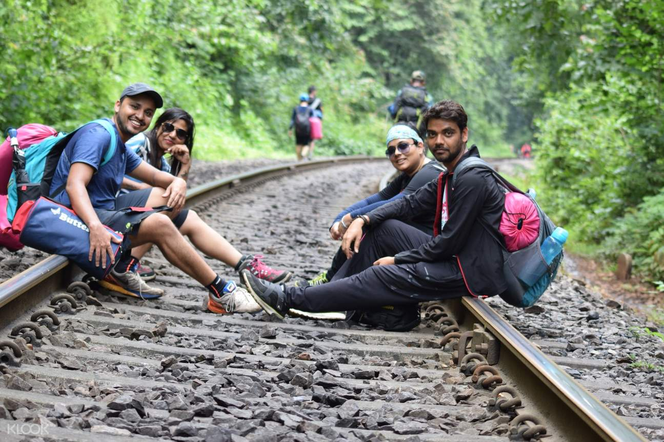 people at the trail of dudhsagar waterfalls