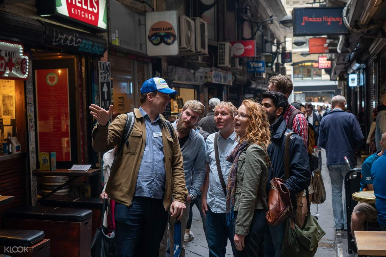 guide showing guests Melbourne laneways
