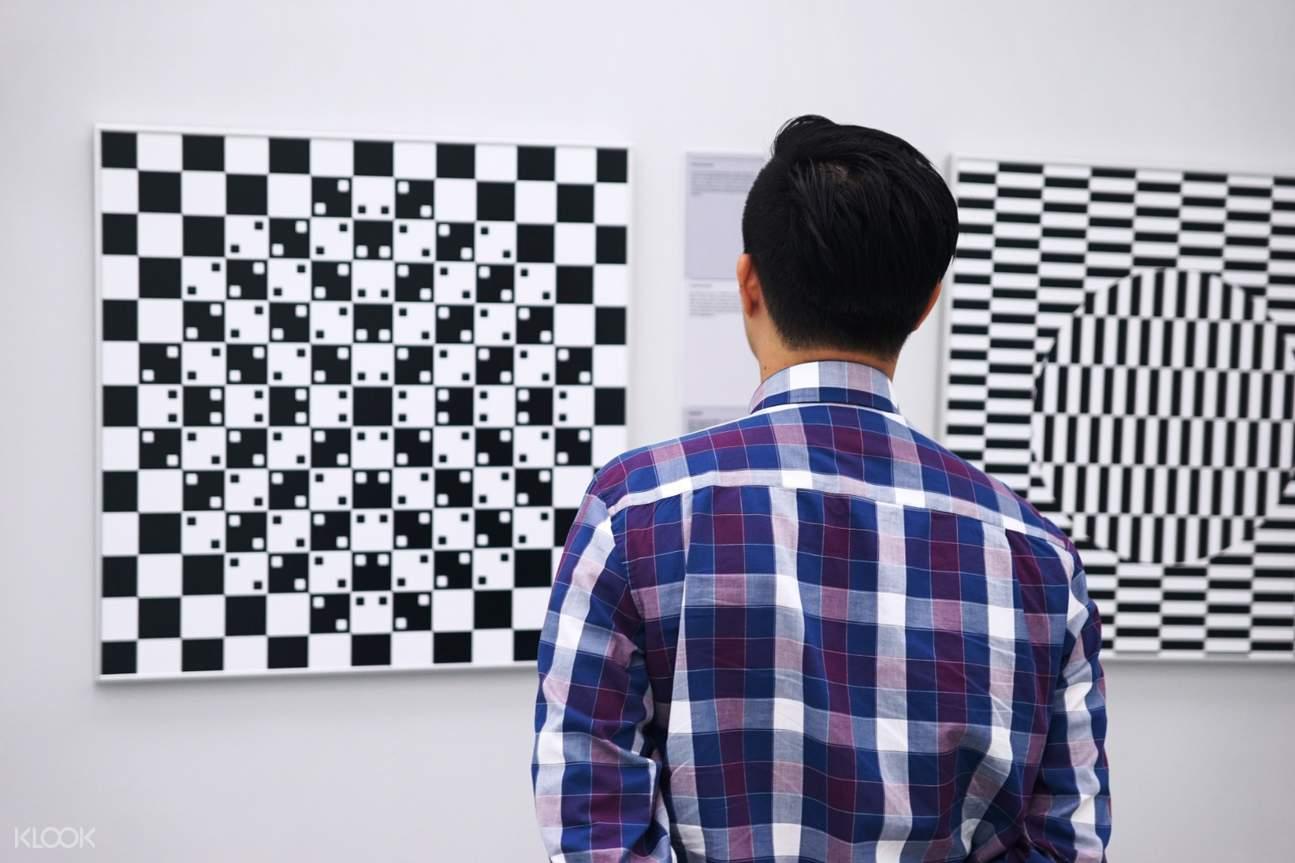 a man looking at an optical illusion display