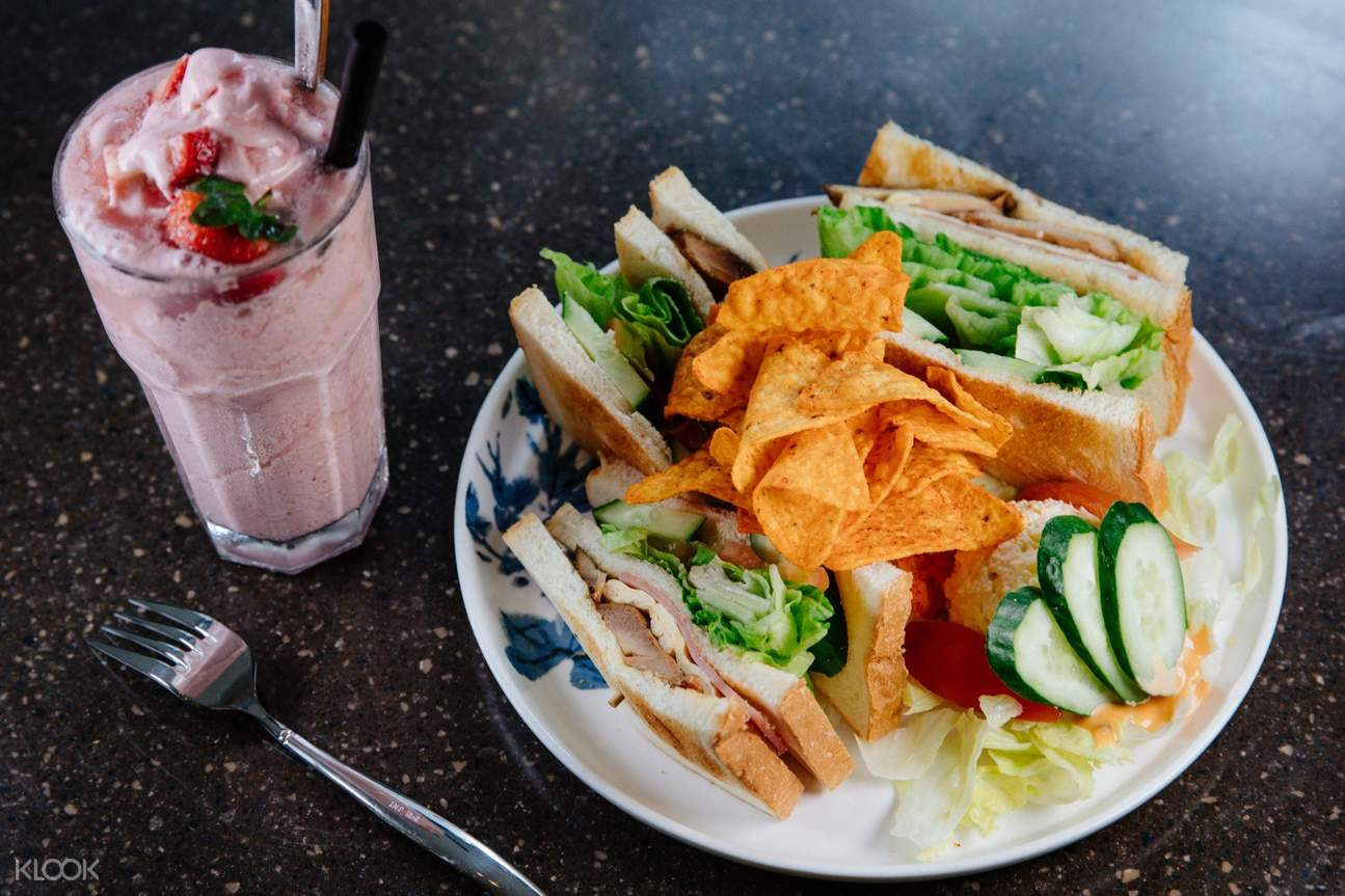 Club Sandwich with Chips & Egg Salad with a Strawberry Smoothie