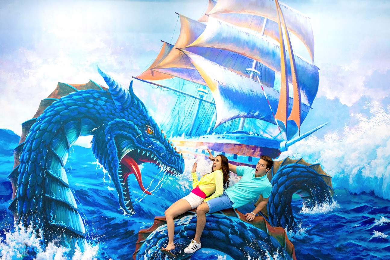 a couple posing with dragon painting