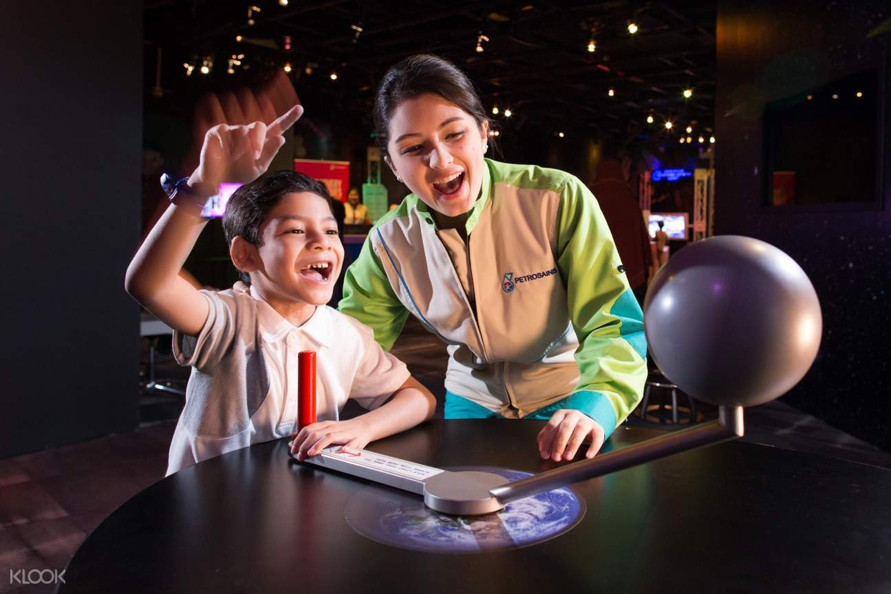 kid and guide in petrosains the discovery centre installation