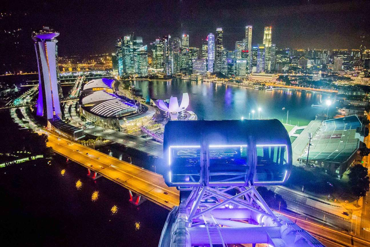 a view of Singapore at night from the Singapore Flyer
