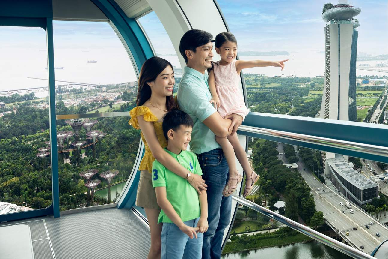 a family in the Singapore Flyer during the day