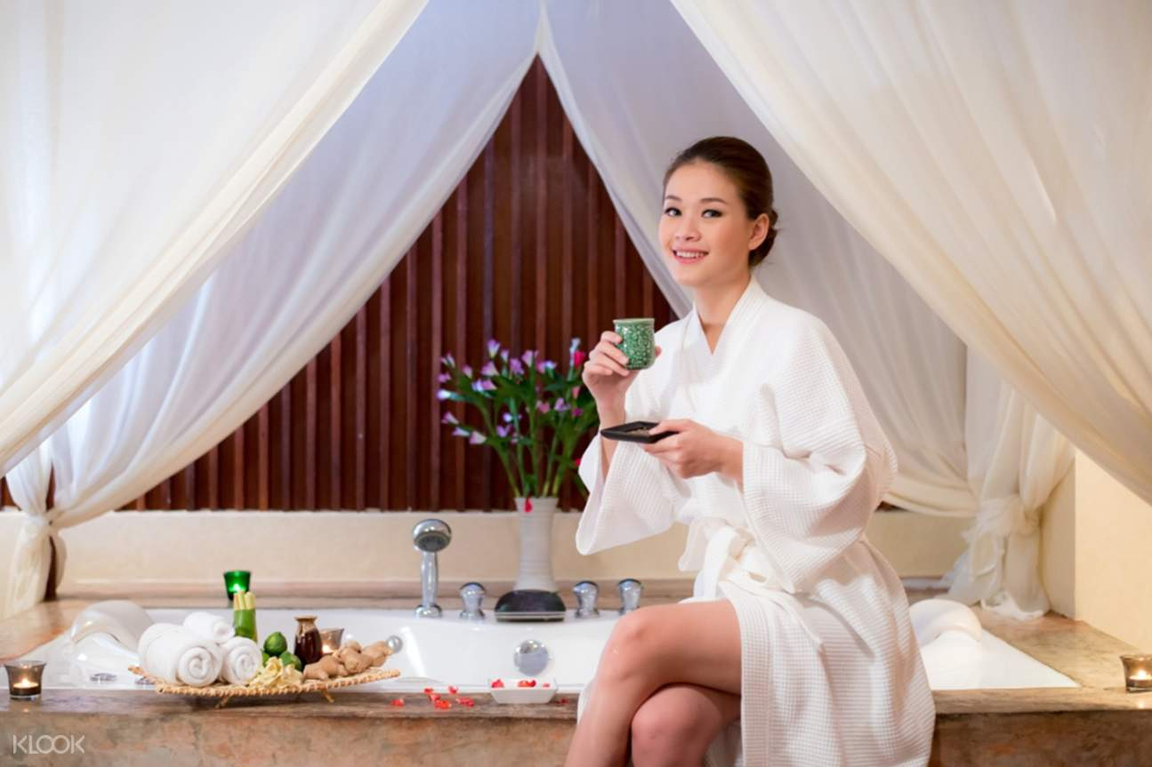 woman drinking tea at the peak spa and beauty salon in chiang mai