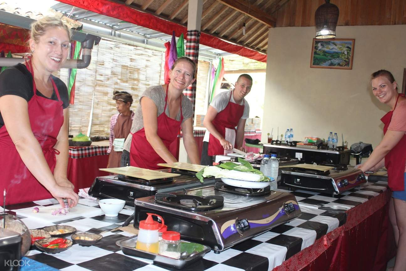 people smiling while cooking in ubud