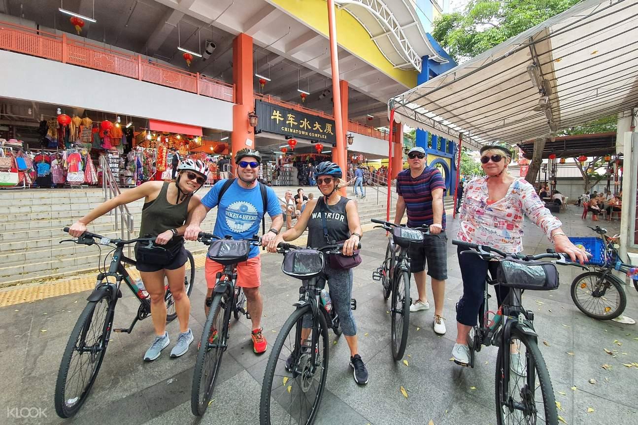 tourists on bike in chinatown