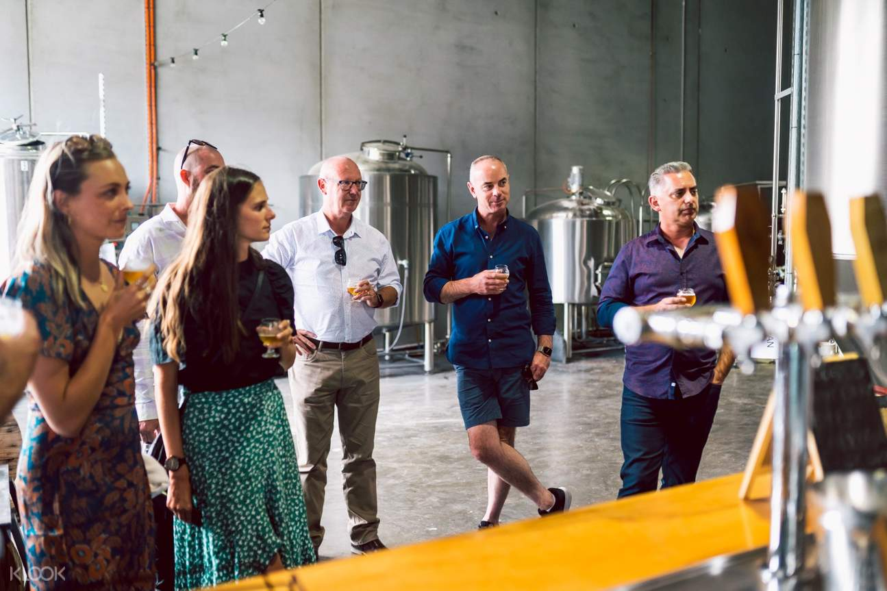 tour group drinking alcohol in tasmania beer tour