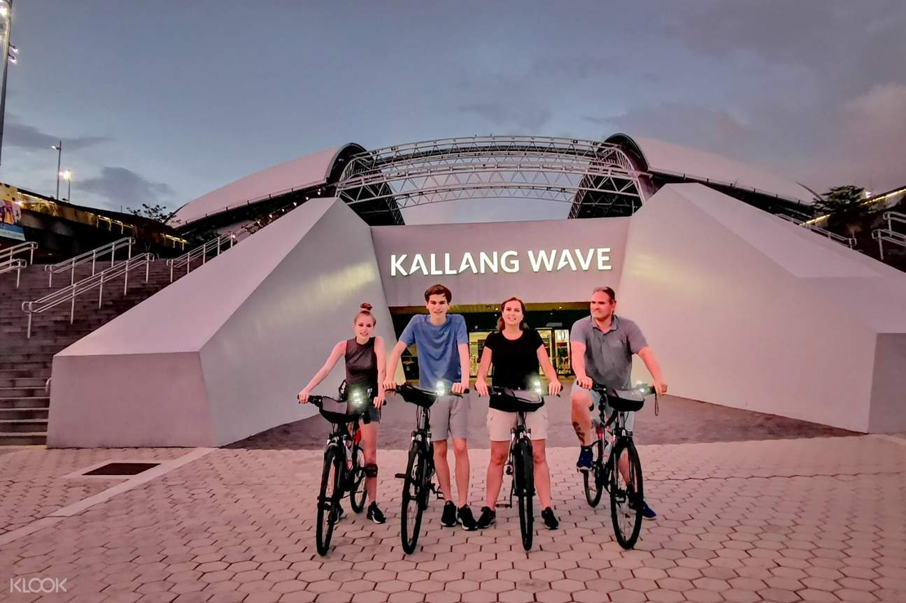 tourists in front of  kallang wave mall